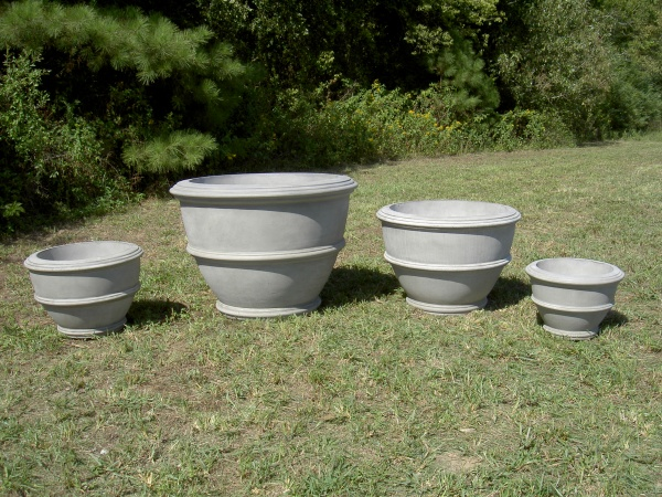 "#019 Small Anderson Planter, Dia., Exterior: 27""; Interior: 21""; Base: 15""; Height: 19"" (250 lbs.), #060 Mammoth Anderson Planter, Dia:, Exterior: 46 1/4""; Interior: 36 3/4""; Base: 24 1/2"";Height: 33"" (950 lbs.), Large Anderson Planter, Dia., Exterior: 36""; Interior: 29""; Base: 15"", Height: 25"" (250 lbs.), #021 Anerson Jr., Dia.:, Exterior: 22""; Interior: 17""; Base: 11 3/4""; Height: 15 1/2"" (109 lbs.)"