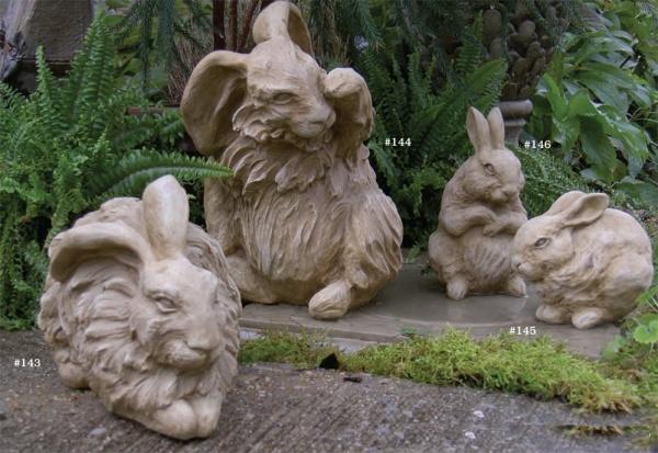 """#143 Resting Angora Rabbit, 11 1/2"""" L x 7"""" x 7"""" (15 lbs.), #144 sitting Angora Rabbit, 13"""" H x 8"""" x 8"""" (17 lbs.), #145 Baby Resting Rabbit, 4 1/2"""" L x 3 1/2"""" x 3"""" (5 lbs.), #146 Baby Sitting Rabbit, 3 1/4"""" L x 5"""" x 4 1/2"""" (5 lbs.)"""