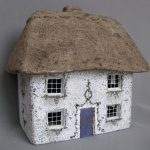 "New! The Alpine Cottage, #561 measures 16"" x 11"" x 15.25"" High and 19.5 lbs."