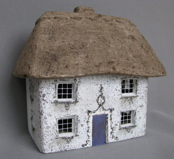"""New! The Alpine Cottage, #561 measures 16"""" x 11"""" x 15.25"""" High and 19.5 lbs."""